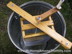 When I first started beekeepeing, I decided to build my own honey extractor. This is hand built from a NEW trashcan and was coated with Cam-kote food grade paint. It is a lot of work to use but it …