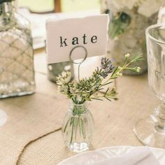 Simple and clean: flowers in a clear vase for tables (Ignore name tag)