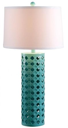 This teal lamp with white drum shade from Kenroy International is a pretty way to add a pop of color in your neutral bedroom or living room.