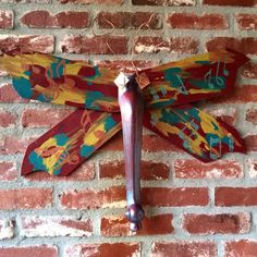 WingingThis presents NOLA Night Flight Dragonfly created from ceiling fan blades and table leg. Upcycled * Recycled * Repurposing * DIY*  Lots of fun.  Check out all my dragonflies at www.wingingthis.com