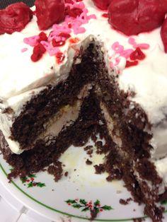 Interior of v-day cake:  Devil's food cake  Lemon curd  Raspberry butter cream frosting.