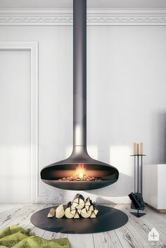 """42 Lovely Scandinavian Fireplace To Rock This Year. A stone fireplace design your pioneer ancestors would envy is the """"Multifunctional Fireplace."""" The hearth is built up high to create a storage a. Suspended Fireplace, Hanging Fireplace, Stove Fireplace, Fireplace Wall, Fireplace Ideas, Freestanding Fireplace, Floating Fireplace, Rustic Fireplace Mantels, Fireplace Inserts"""