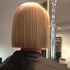 This is an achievement of haircutting prowess - exquisite execution of the bluntest of straight bobs. OK, it's a bit long for my tastes usually but it is so very good that I can make an exception. (Blunt Bob - don't try this unless you are blessed with dead straight hair!)
