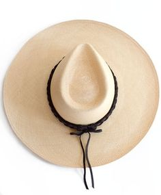 Keep the sun spots away with these massive hat. Also great for throwing shade. Braided Panama hat by Ryan Roche