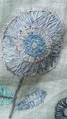 Love the embroidered flowers on this Sophie Digard linen wrap