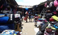 A photo on the topic(s): market place, seller, people, bags, backpack, luggage, missebo, flea market, buyer, client, woman,