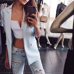 crop top. ripped jeans. blazer.