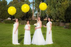 Yellow Spring Wedding Decor Balloons Bride Unique Wedding Decor Ideas. Bridesmaid Dresses: Joanna August. WTOO Wedding Gown Photo by: Modified PhotoGraphics PRESENTED BY WHITE DAISY EVENTS