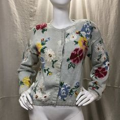 The ultimate 1980s sweater; slouchy, boxy and big shoulder pads.  Details Size: S Chest: 38 Shoulders: 20 Sleeve: 20 Length: 20 Waist: 36  Label: Adrienne Vittadini, 45% Cotton, 55% Ramie, Made in Hong Kong Colors: Blue, Green, Red, Yellow, Grey & White Condition: Excellent