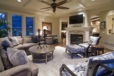 I like how the fireplace stands alone making the room look bigger and open!!!!