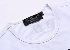 On the left is the tag on a Real Philipp Plein T-shirt. And on the right is  the tag on a Fake Philipp Plein T-shirt. 6a7563ad56