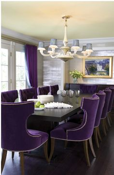 Love the luxury added by purple velvet dining chairs