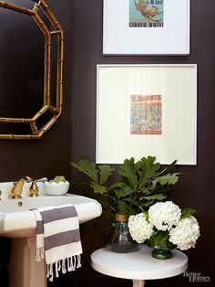 It's a widely held belief that dark colors make small spaces feel even tinier. But deep, dark colors actually have the power to add the illusion of space. Here, a pint-size bathroom feels cozy and a little more spacious thanks to ebony walls. The Color: Urbane Bronze, SW7048 -- Sherwin-Williams