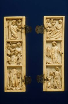 Panel (wing)  14th century  DIMENSIONS 13.21 x 3.81 x 7.62 cm   MEDIUM OR TECHNIQUE Ivory, silver Vertical panel with figures in high relief representing; St. Christopher, Thomas of Canterbury, St. Denis. Two silver hinges on right side. Mate to 51.6.
