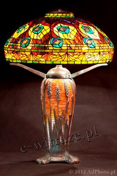 Wieniawa Piasecki lamp, inspired by L.C. Tiffany  #tiffany #lamp www.e-witraze.pl #manmade #mosaic #stainedglass #handcrafted #unique #metalware #louis #comfort #glass #flower #flowers  #tablelamp www.e-witraze.pl #poland #design #art #light
