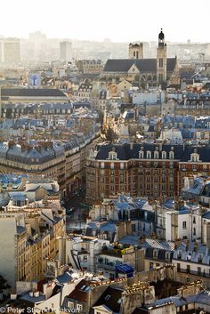 Paris rooftops by Klinkvort, via Flickr