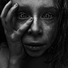 The use of the various shades of grey and black are very symbolic and really show true sympathy and emotions. The use of sharp lines is effective in showing theres a deep message. It makes me want to sympathise with the girl. The textures are very human/life like giving it a real feeling.