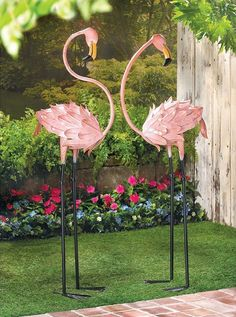 Flamingo Garden Stakes.Brighten your favorite space with a luscious touch of the tropics. These life-sized metal flamingo sculptures make a colorful splash.