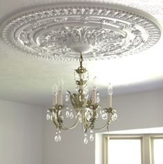 How to install a ceiling medallion.  Must remember... if we ever get a house :)