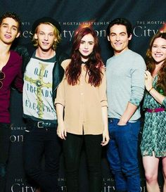 Right to left- Robert Sheehan, Jamie Campbell bower, Lilly Collins, Kevin Zegers, jemima west. ( Simon, Jace, clary, Alec, Isabelle.) in order. CoB cast