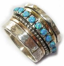 .the stone is nice. And does the middle turn? Beautiful work.