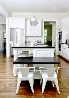 Modern white kitchen white black countertops: Photography : Clea Shearer Read More on SMP: http://www.stylemepretty.com/living/2016/07/21/this-organizers-home-will-give-you-maje-motivation-to-clear-the-clutter/
