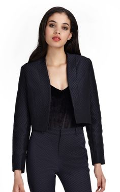 An unerringly romantic brocade jacket- featuring cropped sleeves and a clean silhouette. The jacket is fitted with a contemporary design, making it the ideal chic party jacket. Wear it with the matching trousers for a modern twist on the classic trouser suit.