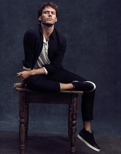"""Promoting The Hunger Games: Mockingjay Part 2, which arrives at theaters November 19, 2015, Sam Claflin appears in Men's Health UK's supplement Urban Active. Claflin is photographed by Neil Gavin for the outing, hitting the studio for striking portraits. Being compared to The Hunger Game's characterization of Finnick Odair as a """"six-foot, tanned, blonde, green-eyed …"""