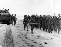 Utah Beach, German prisoners escorted by men of the US ID (may be the Inf Regt), the Sherman is part of the or Tank Battalion. The second GI still has the waterproof case for his gas mask: D Day Normandy, Normandy Beach, World War One, Second World, 4th Infantry Division, D Day Invasion, D Day Landings, Bad Picture, Prisoners Of War