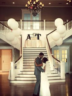 Kendall Plantation - San Antonio-area Venues - Grand staircase with oversized white balloons