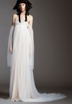 CHLÓE is a light ivory V-neck silk mermaid wedding gown with illusion high neck accented by hand placed Chantilly lace applique by Vera Wang.