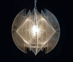 This 1960s hanging light fixture made of plexi-glass and plastic filament was inspired by designer and sculptor Naum Gabo in the late 1960s. $225