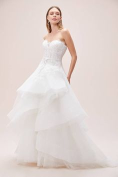 Sweetheart ball gown wedding dress with lace scalloped bodice, dramatic tiered skirt and thin belt detail Sizes available: Colours available: Ivory/Stone Wedding Dresses With Flowers, Tulle Wedding, Dream Wedding Dresses, Gown Wedding, Bridal Gowns, Girls Bridesmaid Dresses, Parisian Wedding, Winter Bride