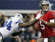 7a6429471 Dallas Cowboys outside linebacker DeMarcus Ware strips the ball from Tampa  Bay Buccaneers quarterback Josh Freeman during the second half of an NFL  football ...