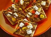 Make the REESE'S Snack Grahams recipe from REESE'S and please the crowd at your next college football party or tailgate!