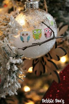 Debbie from Debbie Doo's shares an inexpensive and adorable tutorial for DIY Dollar Tree Christmas Owl Ornaments!