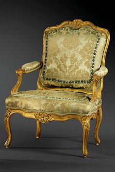 A PAIR OF CARVED GILTWOOD ARMCHAIRS, LOUIS XV, ATTRIBUTED TO LOUIS CRESSON