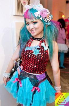Amy Shrinkle (designer Shrinkle Clothing, ceo Sugarpill cosmetics) -- mix flowers, sparkles, lace, and girdle. Fashion Line, Punk Fashion, Beauty Emporium, Sugarpill Cosmetics, We Make Up, Jem And The Holograms, Different Hair Colors, Makeup Store, Cosmetic Companies