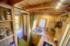A 140 sq ft tiny house on wheels with a fabulous kitchen, loft bedroom, living and dining room, full bathroom, and plenty of hidden storage. Also available for rent on Airbnb.