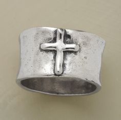 """A cross symbolizes faith on our gracefully curving, 3/8"""" wide sterling silver band. Hand hammering all around lends primitive aspect to this Sundance exclusive. Whole sizes 5 to 9."""