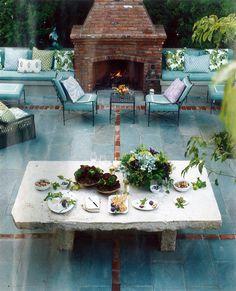 Fireplace and Bluestone Patio with Brick accent -   House Beautiful Magazine Nov 2010