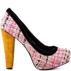 Top off your ensemble with the Topazio. This Jessica Simpson brings the classic tweed style to life with its pink multi color fabric twilled with metallic. A black suede piping trims the top while a 3/4 hidden platform and fur covered 5 inch heel perfect this pump.