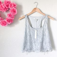 Lace Cropped Overlay Tank So innocent and girly! Brand new with tags! 🏷 Light gray lace, very soft. Racer back. So freaking adorable. Body material is 53% Nylon and 47% Polyester, and the lining is 100% Polyester. Size small. Lauren Conrad Tops Tank Tops