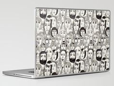 Faces in the Tube by Marina Molares LAPTOP & IPAD SKIN