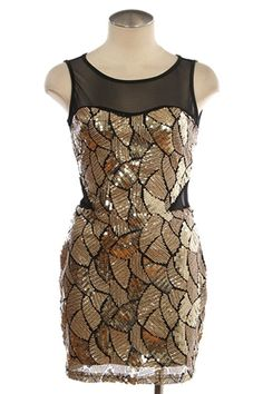 Gold sequin and sheer black party dress.