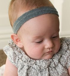 This site has approx measurements for baby's head by age plus a few ideas for headbands