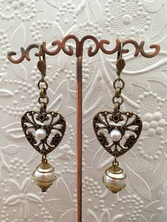 """12/14/14 Earring Challenge Sunday. Earrings made with B'sue heart stamping, caged pearls and no whole pearls, brass ox earwires and rolo chain. Design by Irene Hoffman - Heart's Dezire  """"For Sale"""""""