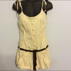 Adorable Romper Zipper side and adjustable tie shoulder straps. No stains, holes or flaws. Tie belt is missing one bead, but it's not noticeable. Pants Jumpsuits & Rompers