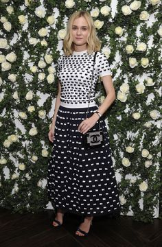 Diane Kruger left the ball gown at home, picking a black-and-white sweater-and-skirt combo instead. The two-toned look continued in her accessories, with the actress choosing a hard-body Chanel bag.