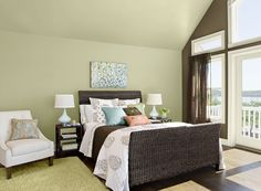 Benjamin Moore Paint Colors - Green Bedroom Ideas - Airy, Elegant Green Bedroom - Paint Color Schemes . . . . . This soft yellow-green is cool and refreshing. . . . . . Wall & Ceiling (wall by head of bed) - Guilford Green (HC-116); Accent Wall (by windows) - Plymouth Brown (HC-73); Trim - Olivetint (519).